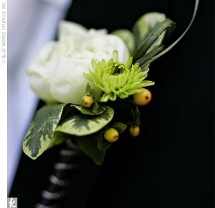 David wore white miniature ranunculuses accented with a green button mum.