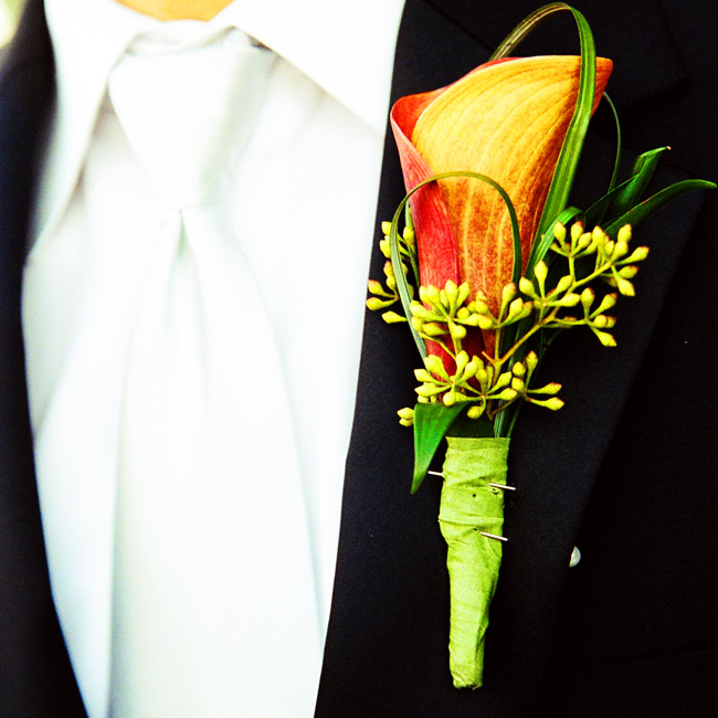 To match his bride's bouquet, Jimmy wore an orange calla lily boutonniere with looped bear grass.