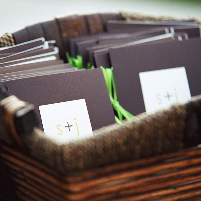 "The square programs were made of chocolate brown card stock and a smaller ivory square card printed with the ""S + J"" logo that the couple used throughout their wedding. ""It was a clean, simple, modern look we wanted to achieve with all of the paper products,"" Sylvia says."