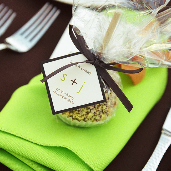 In keeping with the fall theme, Sylvia and Jimmy gave guests caramel-dipped Granny Smith apples. Each apple was wrapped in clear cellophane and tied with either a brown or green satin ribbon.