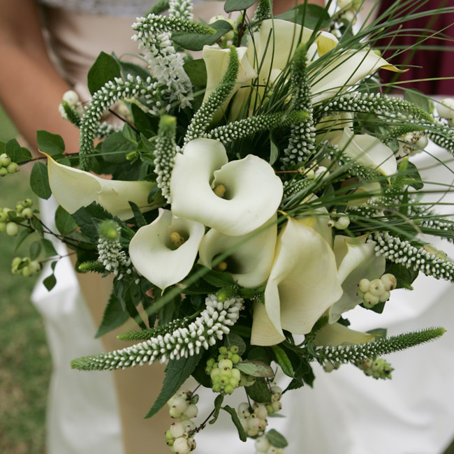 Julie Grace carried a bouquet of French calla lilies, white veronica, and bear grass.