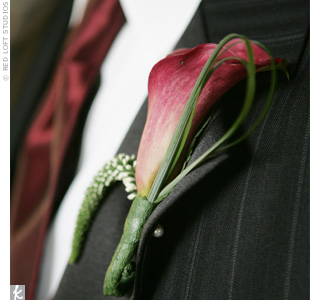 Ramsey's groomsmen wore burgundy mini French calla lily boutonnieres to match their vests and ties, while Ramsey wore a white mini French calla lily.
