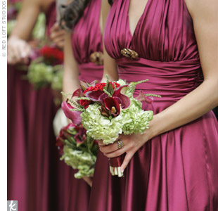 Julie Grace's seven bridesmaids carried bouquets of wine-colored calla lilies, hydrangeas, cockscomb, and bear grass.