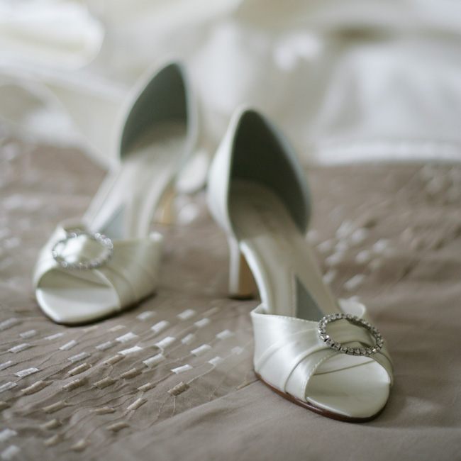 Julie Grace's peep-toe shoes featured crystal brooches.