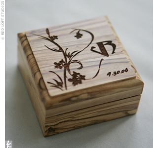 The couple gave their guests engraved, olive wood jewelry boxes with a monogram created by Ramsey. The boxes were made and engraved by the couple's relatives and imported from the Nassar Olive Wood Factory in Bethlehem, Israel. Each box was filled with Jordan almonds and wrapped with tulle.