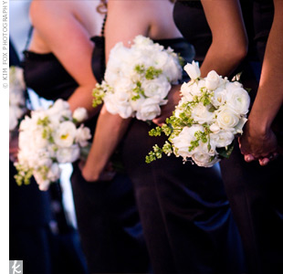 Each of Jennifer's bridesmaids wore a strapless, black, floor-length cocktail dress and carried a bouquet of gardenias, roses, hydrangeas, ranunculuses, and bells of Ireland.