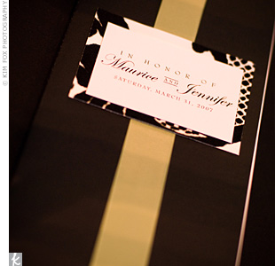 The whole suite of stationery -- including the invites, escort cards, and programs -- was designed to reflect the classic wedding style. A vertical, kiwi green band added a touch of color to each program.