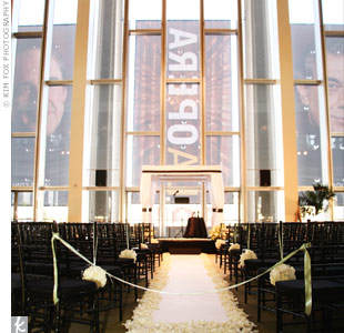 Jennifer and Maurice exchanged vows in the site's Grand Hall, where they stood beneath a huppah made of black-and-white fabric and lined with a tallit (traditional prayer shawl) that had been used in Jennifer's family for three generations.