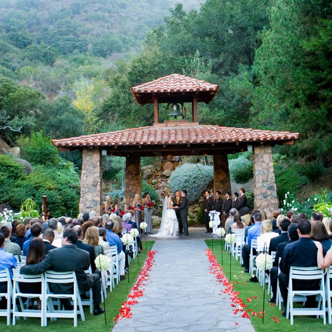 Cari and Steve exchanged vows beneath a huppah in a rustic mission-style gazebo at the Pala Mesa Resort. The sound of a cascading waterfall just behind the gazebo added to the ambience of the natural setting.