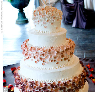 The wedding cake was a family affair -- Cari designed the confection, and her grandmother baked it. The five-tiered cake was covered with champagne buttercream frosting, and every other tier was decorated with handmade gum-paste hydrangeas, which were made with lighter colors at the top ranging to deep rusts at the bottom.