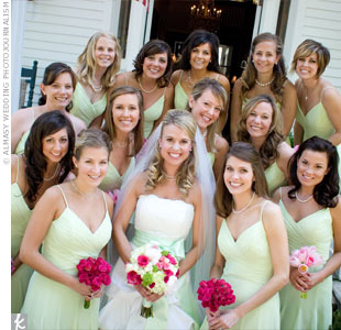 Lauren's 13 bridesmaids wore honeydew-colored dresses with spaghetti straps, V-necks, and pleated chiffon skirts by B2.