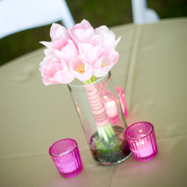 The pale pink bridesmaid bouquets were placed in clear glass vases during the reception.