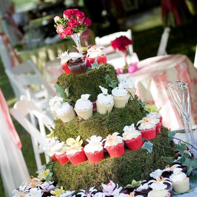"""I love cake, but I especially love cupcakes,"" Lauren says. Three flavors of cupcakes were displayed on moss-covered tiers: Spanish lemon, red velvet, and chocolate Kahlua."