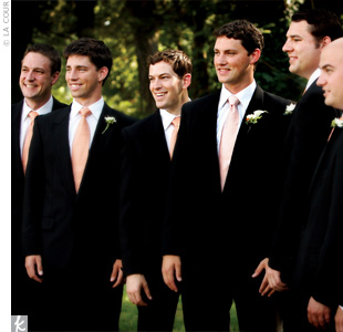 The groomsmen accessorized their black tuxes with peach-colored Ike Behar ties that matched the sashes on the bridesmaid dresses.