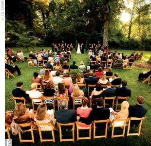 "For the ceremony, padded wooden chairs were arranged to create two aisles toward the rear and a center aisle at the front. ""Somewhat untraditional,"" Jenny says, ""but it gave a more relaxed feeling to the site."""