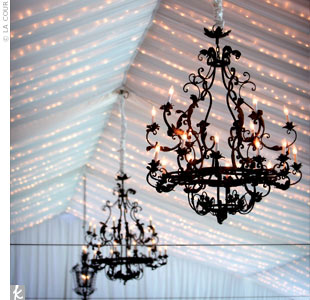 Jenny and Tom enhanced the ambience in and around their tented reception space by hanging chandeliers.