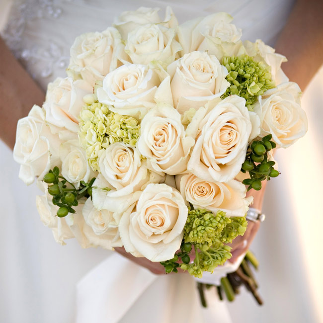 Kirstin carried a simple bouquet of white roses accented with greenery.