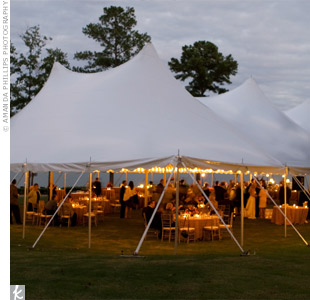 Following the ceremony, everyone gathered beneath a large white tent for the reception. The open-air space glowed with candlelight and offered stunning views of Lake Oconee.