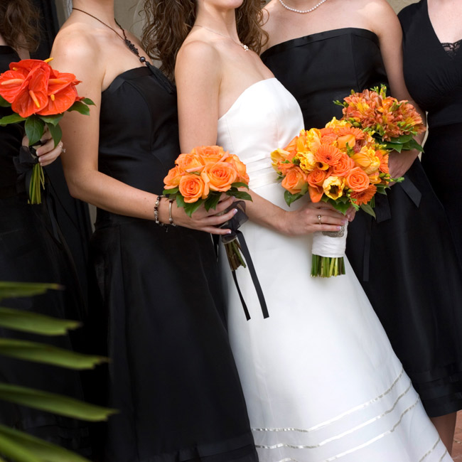 "Emily doesn't care for the term ""bridesmaid,"" so she dubbed four of her pals her ""friends of honor."" Three of them wore strapless, black, organdy, tea-length dresses from Dessy, while the fourth wore her own dress in a similar style."