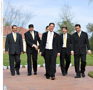 The groom and guys wore their own black suits. Binyamin wore a black, Mandarin collar, four-button, Armani suit.