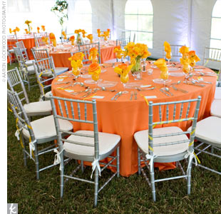 Though Emily and Binyamin chose minimal decor for the ceremony and cocktail hour, their vibrant palette kicked in for the reception. The tables were covered in orange linens with yellow napkins or yellow linens with orange napkins. At each place setting, a single rose in the contrasting hue was wrapped in each napkin.