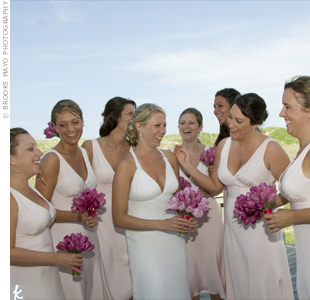 To offset their bright pink bouquets, Katie's maids wore quartz pink, silk, sheath dresses from J.Crew.