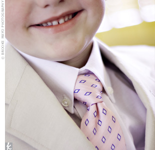 The ring bearer sported a tan suit just like the groom's.
