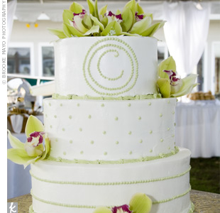 The couple chose a simple, three-tiered, vanilla cake accented with green trim, pink and green orchids, and a C, for Couch, on top. A cookie table featuring several different varieties was a big hit with the kids.
