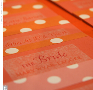Mary used the same fonts and design on the escort cards as the invitations, which were printed with either pink polka dots or orange polka dots, depending on which side of the room guests were to be seated.