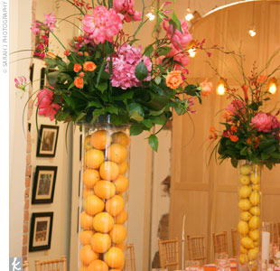 Huge vases filled with either lemons or oranges and cascading displays of peonies, ranunculuses, orchids, and willows wowed guests. The use of citrus also made for interesting dinner conversation, Mary says. Guests were making bets on the number of oranges in the largest vases.
