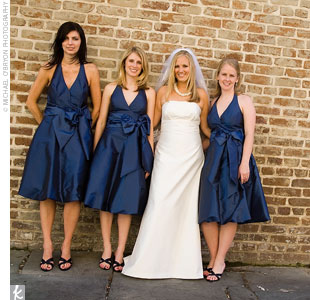In beach-chic fashion, each of the three bridesmaids wore a knee-length, sapphire, halter-neck gown with a bubble hem. Nicki gave her attendants earrings and bracelets custom-made of navy pearls and Swarovski crystals.