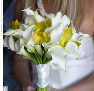 To complement her gown, Nicki carried a hand-tied bouquet of ivory calla lilies and yellow-throated green cymbidium orchids.