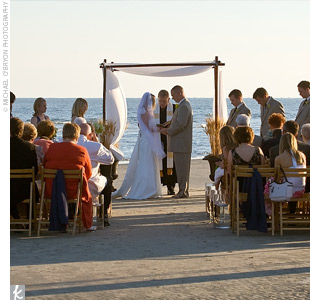 Fifty of the couple's closest family and friends gathered on the beach just before sunset to watch Nicki and Andy exchange traditional vows. To make the ceremony even more special, the couple asked Rev. Doug Burrell, the minister at Andy's home church, to preside over the ceremony.