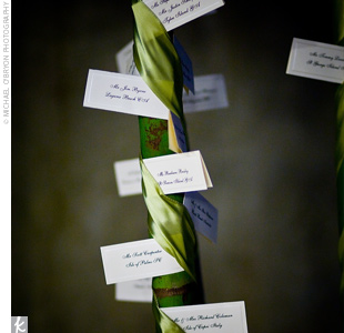 White tented cards with each guest's name were tucked into green ribbon that was wrapped around two palm trees on the terrace.