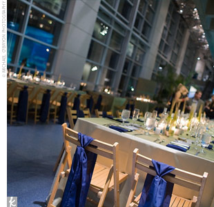 Slated-wood chairs were tied with navy ribbon to incorporate the aquarium's blue hues.