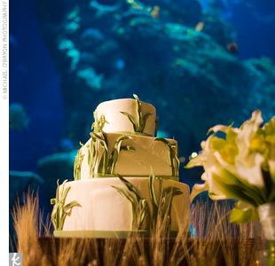 Placed on a wooden box surround by wheat grass, the Italian buttercream-frosted confection seemed to be floating in the aquarium water. Guests enjoyed layers of red velvet cake with custard and chocolate ganache filling.