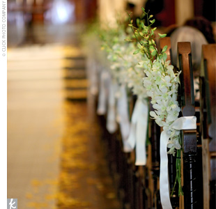 white, pew decorations wedding