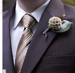 Brian and his groomsmen wore boutonnieres made of wax flower leaf, scabiosa pod, and fiddlehead fern.