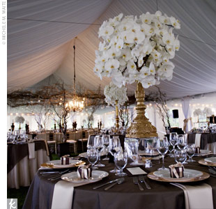 The room was awash with golden accents -- gold chargers and gold-rimmed ivory dishes were set atop tables while gold chiavari chairs finished off the look.