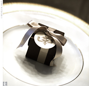 As favors, the couple's cake baker made cake truffles. The sweets were placed in brown boxes, tied with a gold silk ribbon, and finished off with the couple's wedding seahorse crest.