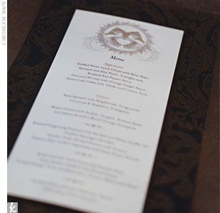 The ivory menus, printed with a gold and brown font, were placed at each place setting