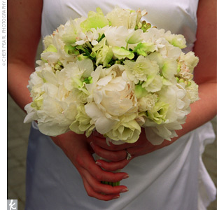 Stefanie walked down the aisle carrying a hand-tied bouquet of white and green peonies, tulips, parrot tulips, anemones, ranunculus, and paperwhite narcissus. The blooms were wrapped with Midori sheer platinum ribbon.