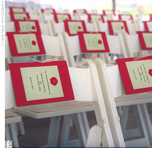 The homemade wedding programs featured a bright red border and motif, which were placed on each chair at the ceremony.