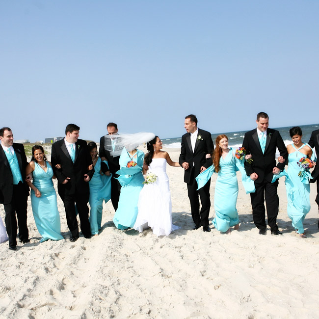 Lydia's maids wore two different styles of pool blue dresses, along with matching satin shawls. The groomsmen wore tuxedos with pool blue vests and ties.