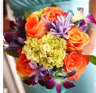 The bridesmaids carried a variety of orchids, soft orange roses, and blue hydrangeas.