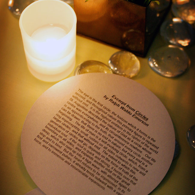 "The couple didn't provide traditional programs -- instead they handed out copies of a reading from Ralph Waldo Emerson's ""Circles"" and printed them on circle-shaped, metallic silver card stock."