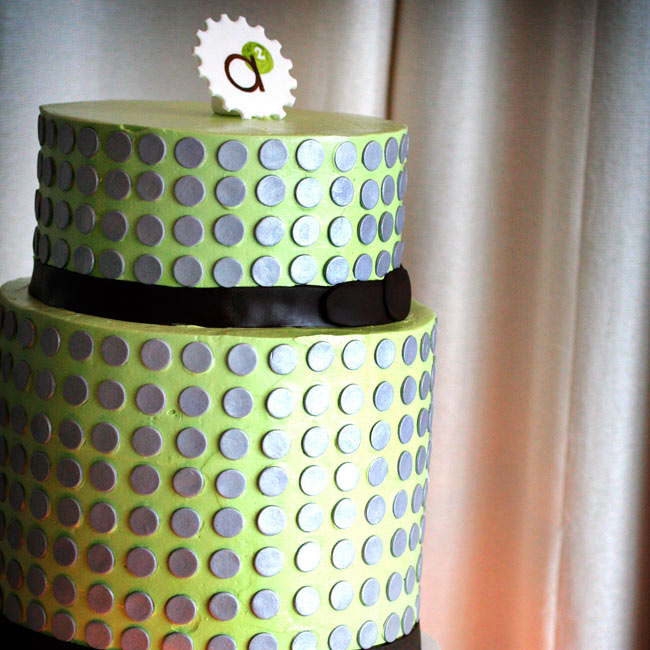 The delectable two-tiered cake was dressed in celery green icing with chocolate brown ribbon and metallic silver dots spaced evenly all over both tiers. Inside was orange cake with chocolate ganache and orange marmalade for one tier and lemon poppy seed cake with raspberry jam and lemon buttercream for the other.