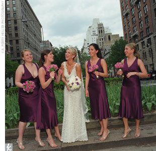 Kimberlys four bridesmaids wore eggplant, silk charmeuse, V-neck dresses with strappy gold sandals. They kept the look casual with loose ponytails and gold, pearl drop necklaces.