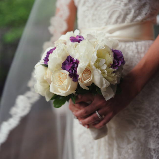 Kimberly wanted something romantic and feminine for her blooms and chose cream-colored peonies and roses with a splash of purple hydrangea.