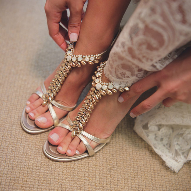 Kimberly's shoes were gold leather, studded with ivory and gold crystal detailing